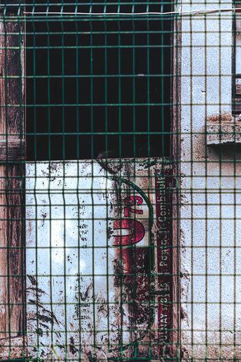 Graffiti on glass window of building