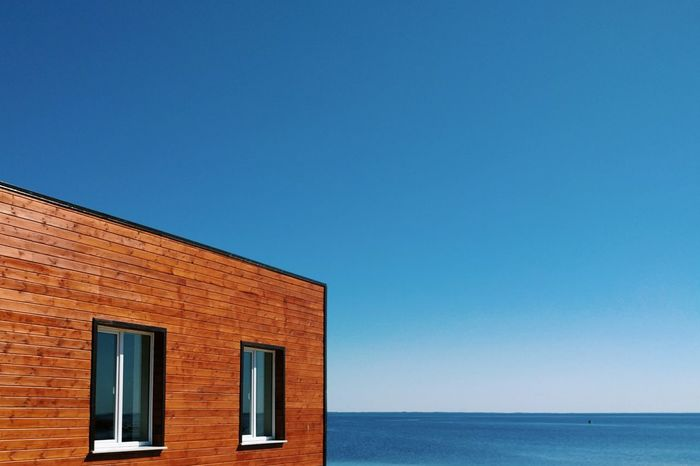 Next to the water Blue Clear Sky Architecture No People Sky Day Outdoors Built Structure Streetview VSCO Streetphoto_color Vscocam Streetphoto Landscape Landscape_Collection Landscape_photography Travel House Water Water Surface Minimalist Architecture