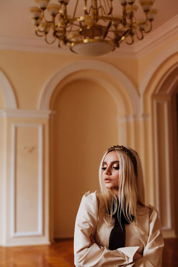 Architecture Dressed Up Fahrrad Fashion Golden Arch Architectural Column Architecture Beauty Blond Hair Golden Lotus Home Interior Indoors  Luxury Magazine Sitting Style Style And Fashion Women Yellow