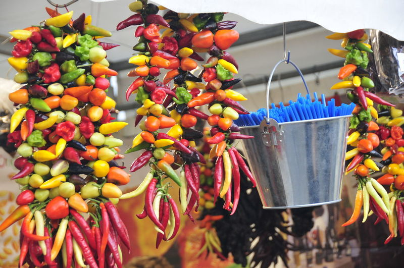 Chilis Food And Drink Food Fruit Healthy Eating Retail  Hanging Multi Colored Choice Wellbeing Market Freshness Focus On Foreground Large Group Of Objects No People For Sale Close-up Variation Market Stall Day Small Business Retail Display Red Chili Pepper Sale