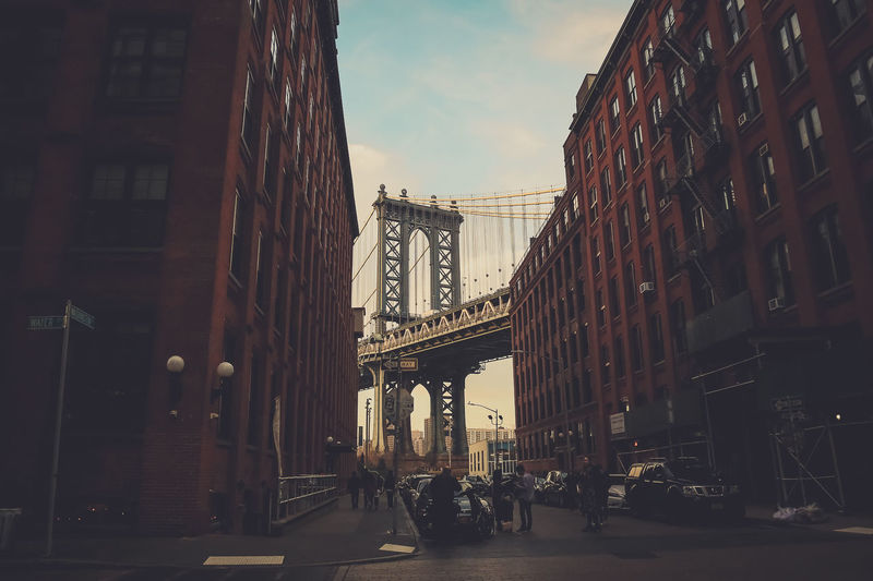 Manhattan Bridge Seen Through Buildings In City