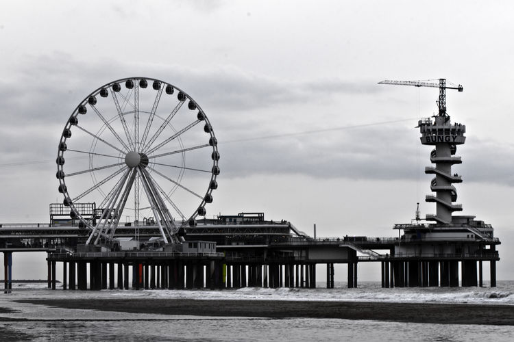 Impressions of the pier and beach at Scheveningen, the beach resort of The Hague in the Netherlands. Den Haag Nederland Netherlands Scheveningen  Scheveningen Beach The Hague Amusement Park Architecture Arts Culture And Entertainment Beach Built Structure Day Ferris Wheel No People Outdoors Scheveningen Pier Sea Sky Water
