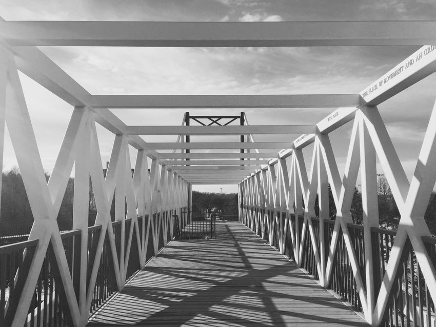 Architecture Bridge Bridge - Man Made Structure Built Structure Connection Day Diminishing Perspective Engineering Footbridge Long Low Angle View Metal No People Outdoors Railing Sky Sunlight The Way Forward Transportation Vanishing Point