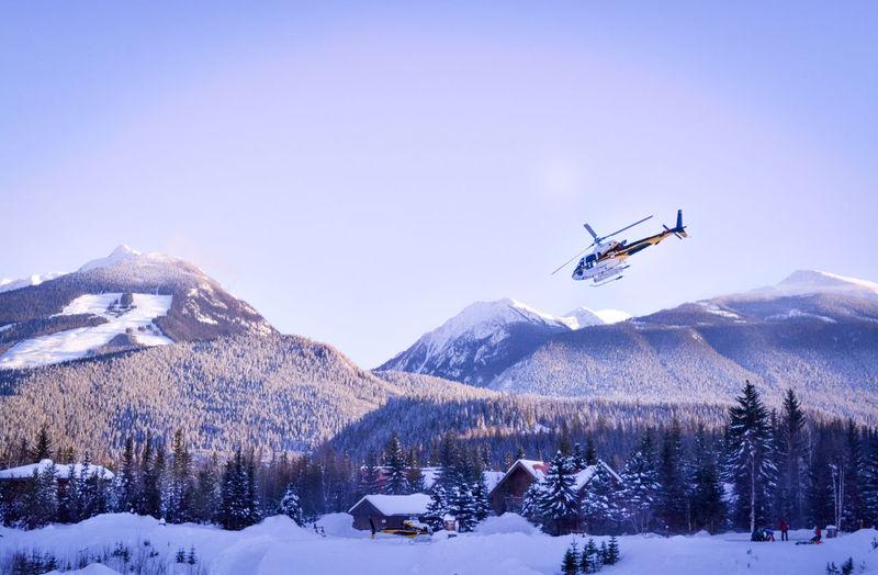 Low Angle View Of Ski Lift Against Mountain Range