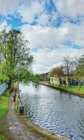 Water Cloud - Sky Sky Outdoors Tree Day Grass Building Exterior Nature People Architecture Lock Canal Tranquil Scene Reflections Towpath Waterfront Solitude Tree Failsworth, United Kingdom.