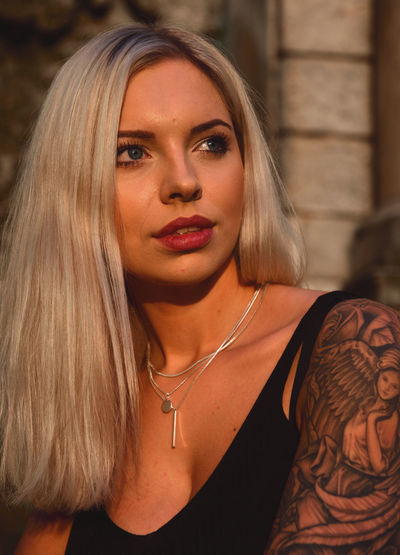 Fashion Tattoo ❤ Tattoos Tattoed Girls Golden Hour Bronze Portrait Beautiful Woman Beauty Beautiful People Looking At Camera Headshot Blond Hair Arts Culture And Entertainment Fashion Females The Portraitist - 2019 EyeEm Awards