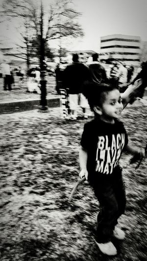 Child Childhood One Person Full Length Day Outdoors Real People Street Photography City Life People And Places. Eyeem Galery Black And White Collection  Demonstration Marching Sunset Eyem Gallery Irwin Collection Little Girl Welcome To Black Resist! Resist By ICP EyeEm Diversity The Photojournalist - 2017 EyeEm Awards