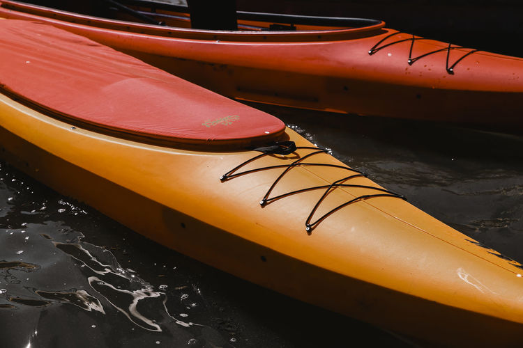 // at the beach // Beach Photography Dark Surf Beach Beachphotography Close-up Day Focus On Foreground High Angle View In A Row Kayak Mode Of Transportation Moored Nature Nautical Vessel No People Oar Orange Color Outdoors Shoe Sport Sunshine Transportation Water Yellow The Great Outdoors - 2018 EyeEm Awards Summer Sports