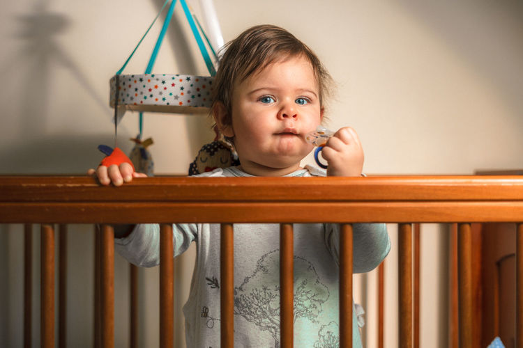 Just woken up baby boy Jr Senol 50mm Babyboy Blue Eyes Domestic Life Family Hands Innocence Looking At Camera Railing Baby Portrait Babyhood Bedroom Blonde Hair Childhood Cot Bed Cute Flash Photography Full Frame Home Interior Mimic Pijama Toddler  Toddler Bed Wakeup Wooden