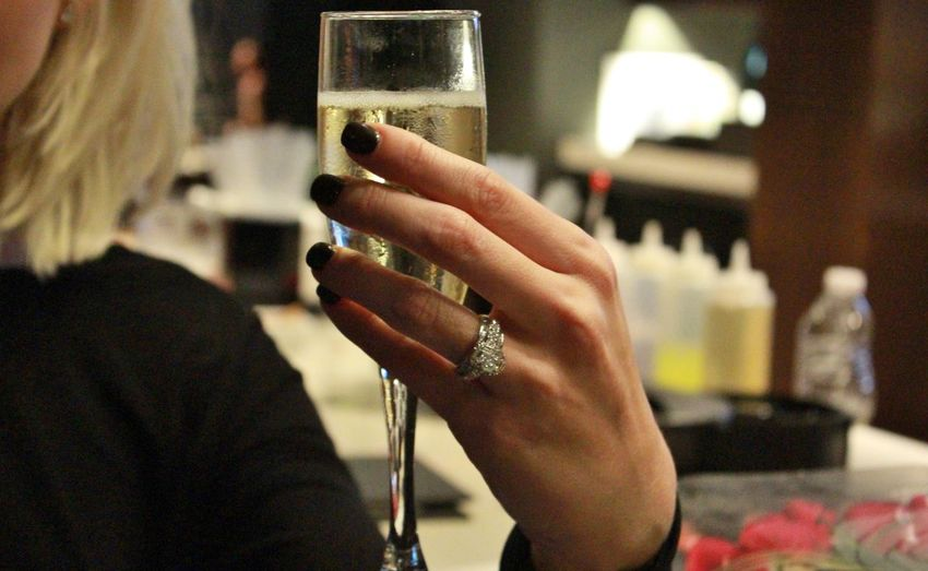 Midsection Of Woman Holding Champagne Flute