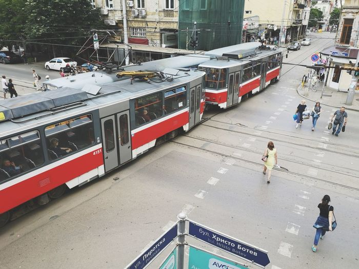 My view for today Sofia, Bulgaria Bulgarian Stories Red Color Redtram Tram Capital Cities  Stockphoto Huaweiphotography Mobile Photography Sofia Bulgaria Cityscape City Life Diagonal Lines Huaweip20pro From My Point Of View Fromabove High Angle View Backgrounds City Train - Vehicle Public Transportation High Angle View Land Vehicle City Life Railroad Track Men Architecture Built Structure Tramway Track