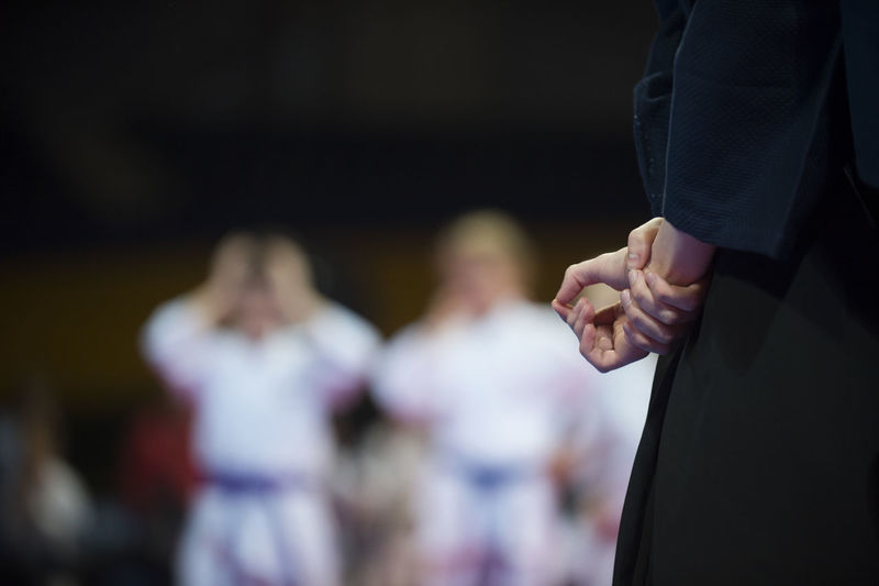 Karate Group Of People Men Focus On Foreground Incidental People Adult People Togetherness Midsection Standing Holding Indoors  Real People Hand Performance Arts Culture And Entertainment Women Event Skill  Music Stage