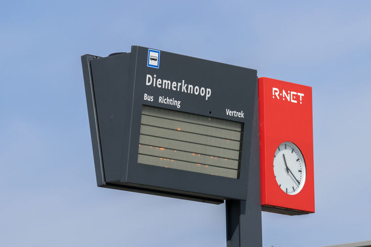 Low angle view of information sign against clear sky