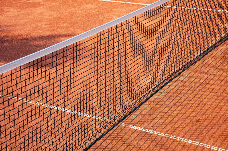 Absence Backgrounds Brown Competition Court Day High Angle View Leisure Activity Match - Sport Nature Net - Sports Equipment No People Outdoors Pattern Red Shadow Sport Sports Equipment Sunlight Tennis Tennis Net