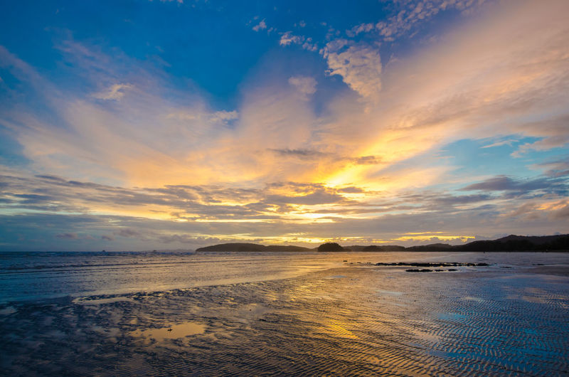 Sunset at the beach Beach Beach Sunset Beauty In Nature Blue Sky Cloud Cloud - Sky Couple Horizon Over Water Krabi Thailand Nature No People Reflection Sand Sand Beach Scenics Sea Seashore Sky Sky Sunset Stone Sunset Sunset Sky Tranquil Scene Twilight Sky Water First Eyeem Photo