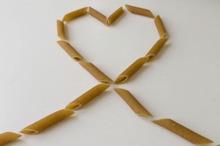 wholemeal pasta Love Pasta Ribbon Art And Craft Close-up Creativity Design Emotion Food Food And Drink Heart High Angle View Indoors  Love Pasta Shape Still Life Table White Background Wholemeal Wholemealpasta