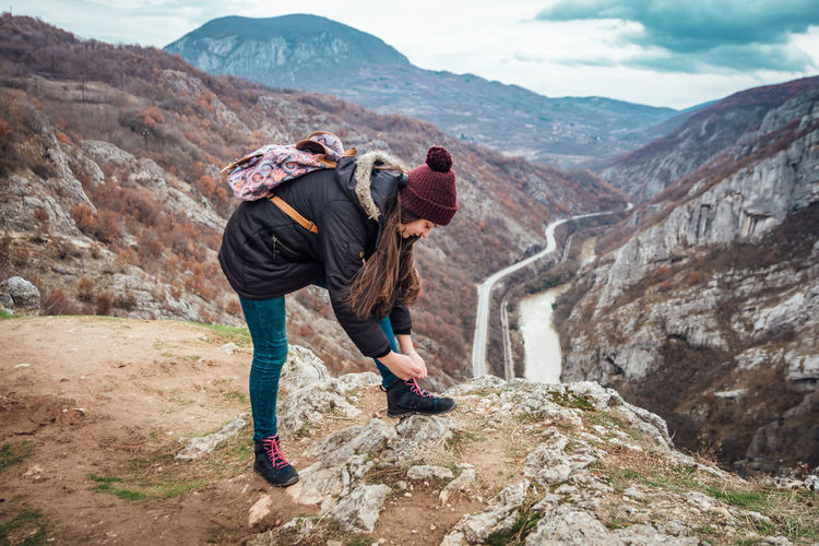 Beautiful picture of the canyon in Serbia, with river and the highway in the middle. Dramatic sky Mountain Rock Real People Leisure Activity Rock - Object Activity Lifestyles Solid Mountain Range Scenics - Nature Beauty In Nature Full Length Adventure Adult Hiking Casual Clothing Women People Non-urban Scene Nature Outdoors Backgrounds Highway River Canyon