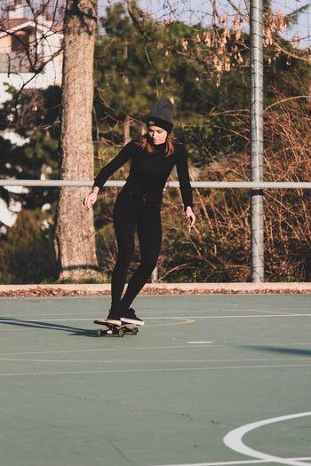 Full Length Of Woman Skateboarding At Playground