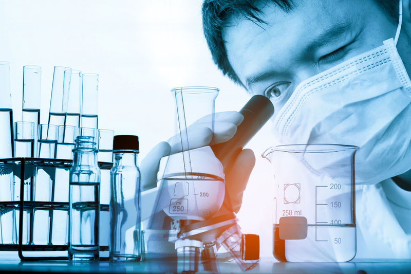 Analyzing Chemical Chemistry Close-up Education Front View Glass Healthcare And Medicine Indoors  Lab Coat Laboratory Laboratory Glassware Occupation One Person Real People Research Science Scientific Experiment Scientist Test Tube Transparent
