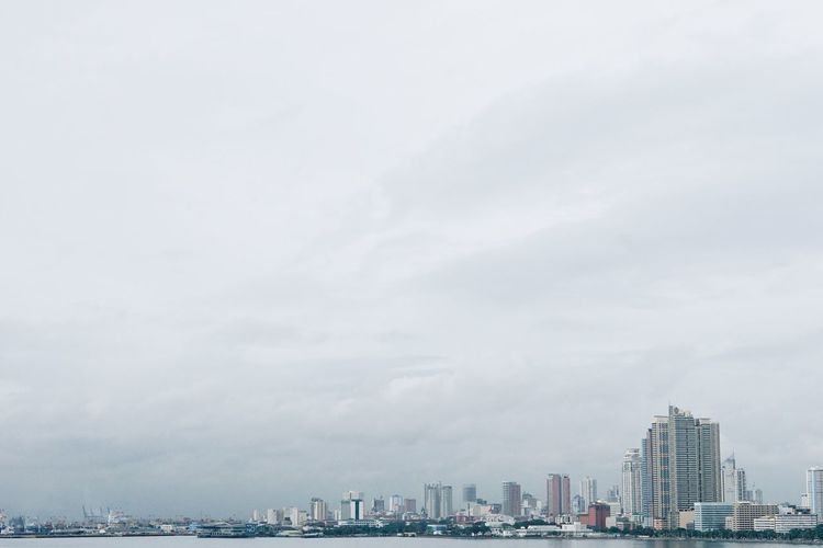 Cityscape By Manila Bay Against Sky