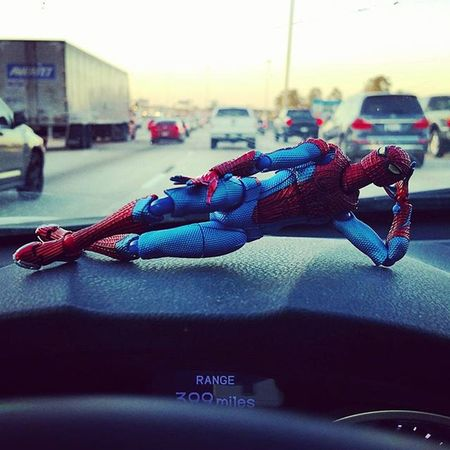 Spidey is chilling while we stop and go on a Friday commute Fwebruary Traffic Day 12 Tgifridays Tgif