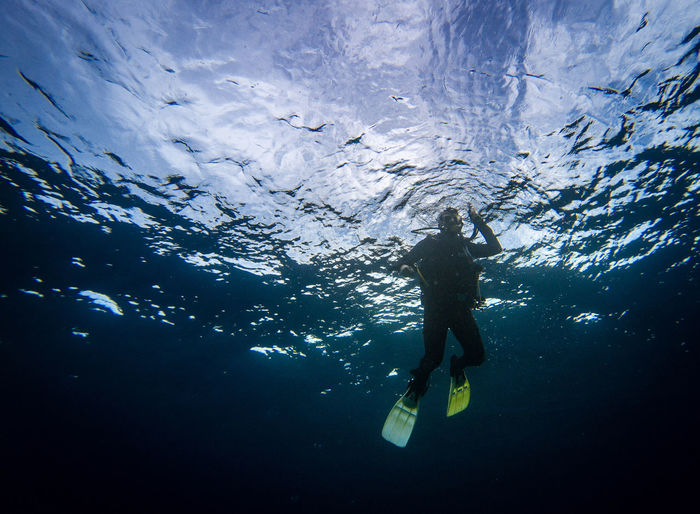 Low angle full length of man swimming in sea