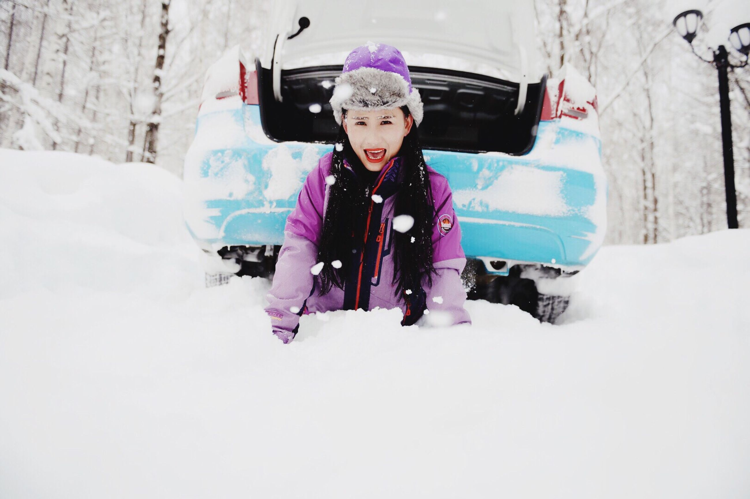 winter, snow, cold temperature, lifestyles, leisure activity, season, looking at camera, warm clothing, portrait, person, front view, full length, childhood, happiness, casual clothing, smiling, enjoyment, fun, standing