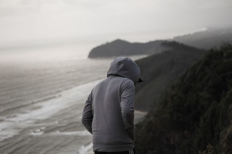 A man with hoodie on the top of mountain beside the sea. Hiking Hiker Malaysia Style Moody Bukit Keluang Besut Sand Cold Temperature Winter Vacations Outdoors Walking Men Fog Nature Warm Clothing Day Adventure Landscape