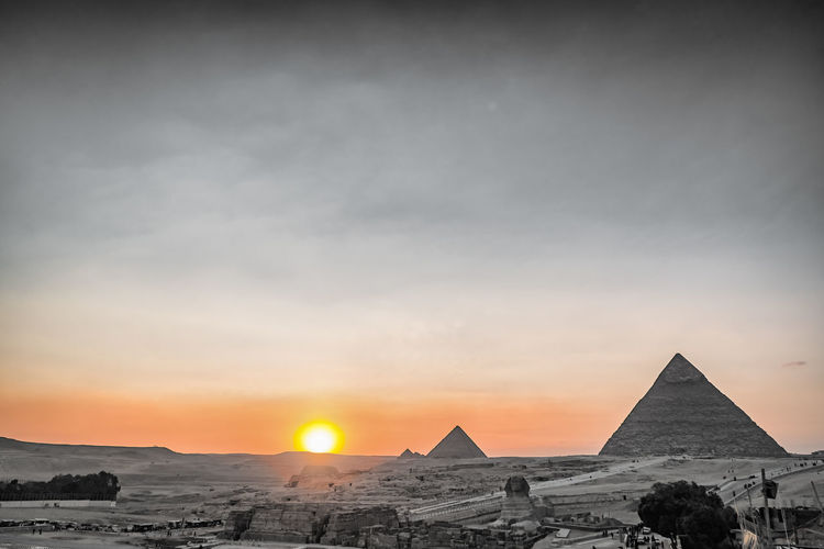 Sky Nature Outdoors Pyramids Egypt Desert Travel Tourism Destination Beautiful Ancient Structure Ruins Giza Cairo Sphinx Pyramid Sunset Ancient Civilization Architecture Travel Destinations The Past Scenics - Nature History Built Structure Beauty In Nature Tranquil Scene No People Land Sun Climate Archaeology Arid Climate Ancient History