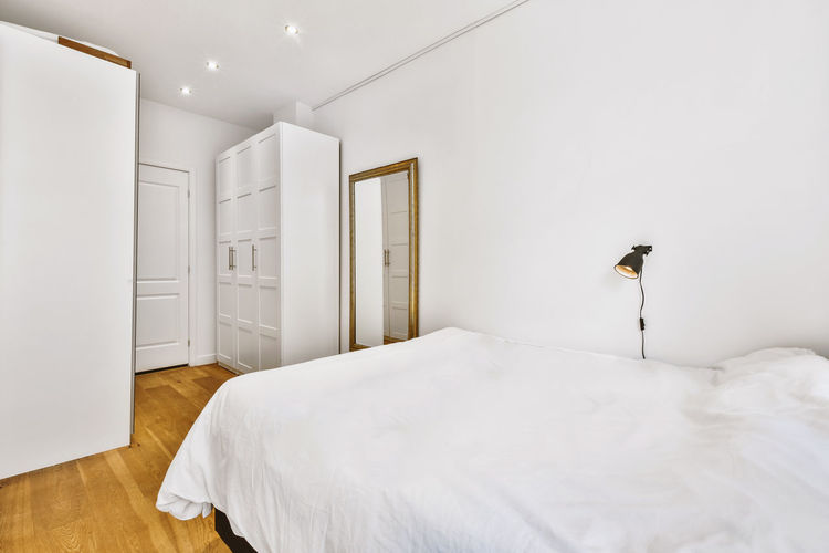 White wall in bedroom