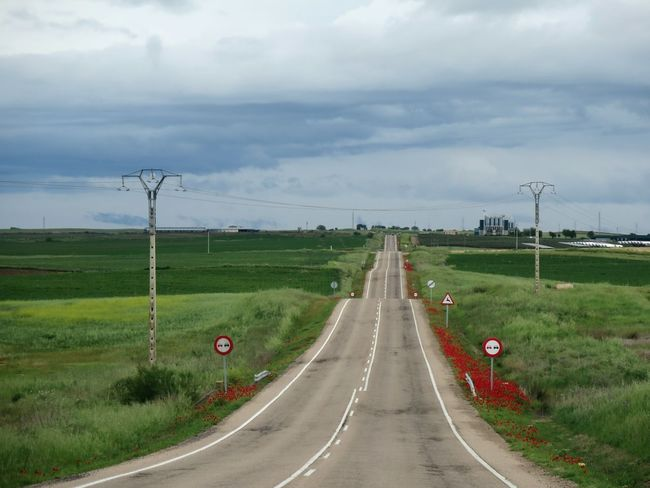 Cloud - Sky Landscape Road No People Outdoors Grass Sky Day Nature Beauty In Nature Poppy Flowers Poppy Nature Agriculture Environment Environmental Issues Wires