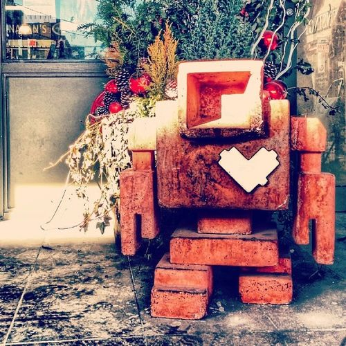 The Lovebot: Basking in the Winter sun, spotted on Baldwin St. Lovebots KensingtonMarket Toronto UrbanART