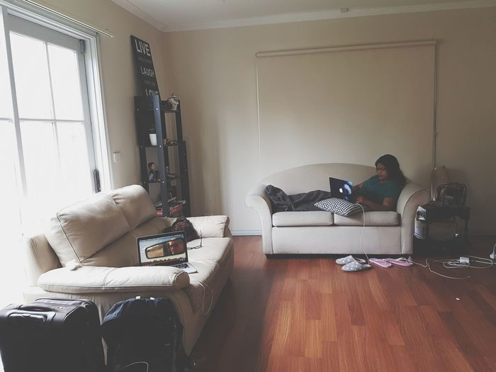 A lazy rainy day inside home! Indoors  Sofa One Person Domestic Life Living Room Technology Sitting Window Home Interior Casual Clothing Eyeemmarket The Week On EyeEm Weekend EyeEmSelect Rainy Morning Aroundtheworld Women Enjoying Life Lazy Day Cozy At Home Cozy Place Melbourne