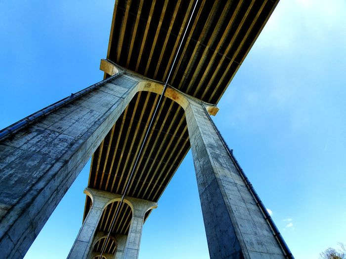 Rustic Rusty Metal Low Angle View Clouds And Sky Sky And Clouds Geometric Shape Transportation City Innovation Blue Clear Sky Sky Architecture Built Structure Bridge - Man Made Structure Arch Bridge Underneath Engineering My Best Photo The Minimalist - 2019 EyeEm Awards
