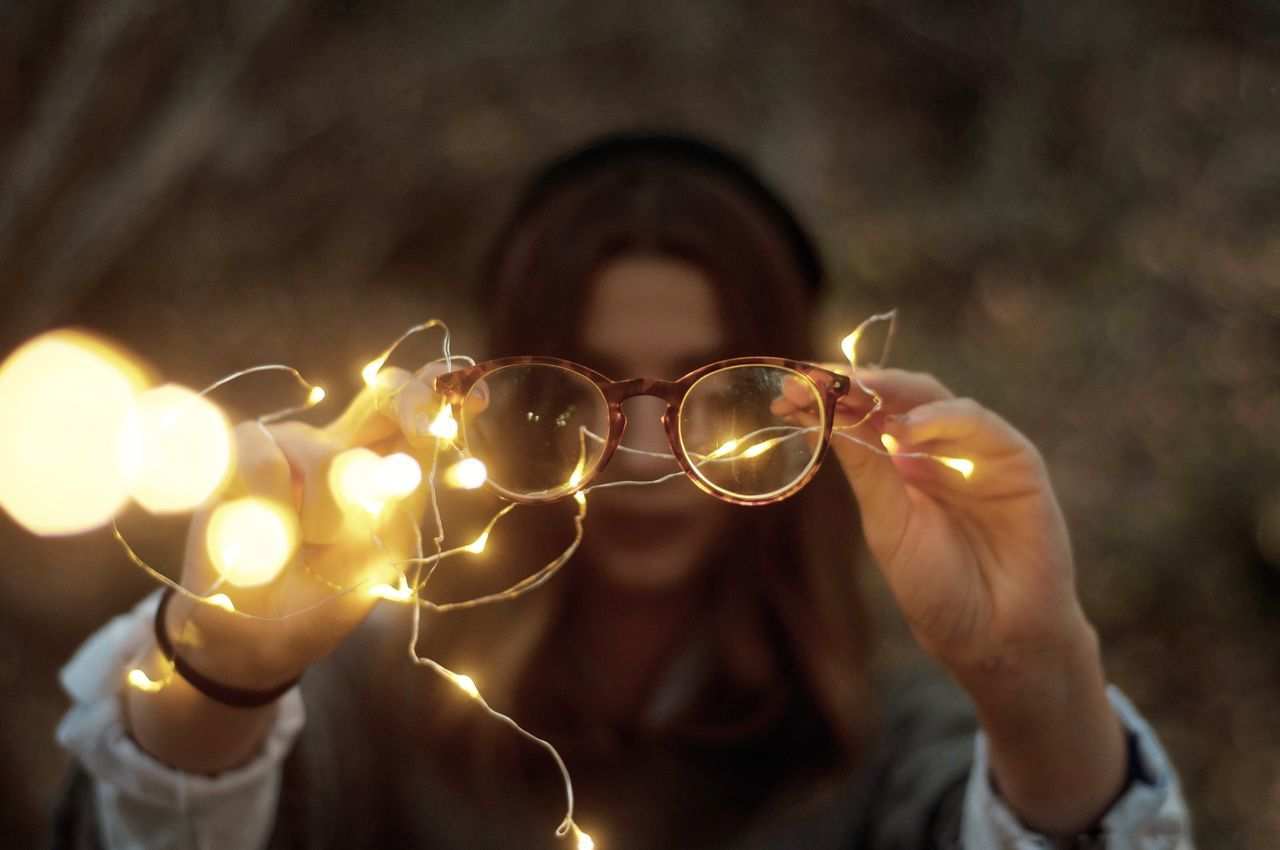 Close-up of woman holding eyeglasses