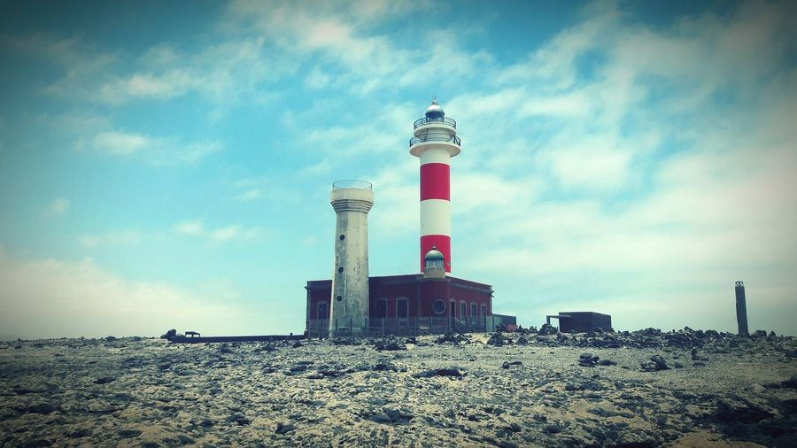 faro EyeEmNewHere Eyemphotography Nikon5500 Nikon Huawei Relax Eyembestshots Lighthouse Sea Protection Beach Safety Sky Cloud - Sky Architecture Building Exterior Lookout Tower Observation Point Tower Lifeguard Hut Lifeguard  Communications Tower Coin-operated Binoculars Tall Weather Vane
