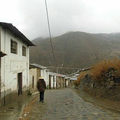 Rain Walking Rear View Mountain One Person Adult Architecture Sky Extreme Weather People Outdoors Day Adults Only