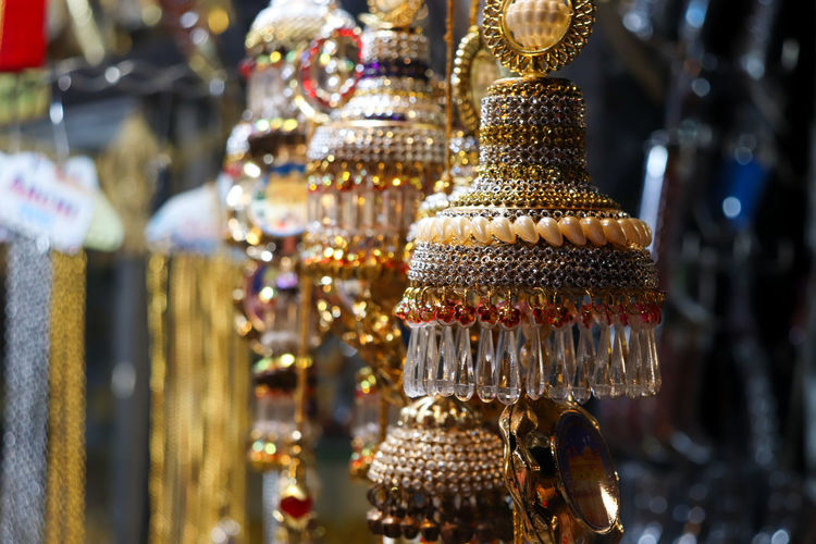 Close-up of decorations hanging in store for sale at market
