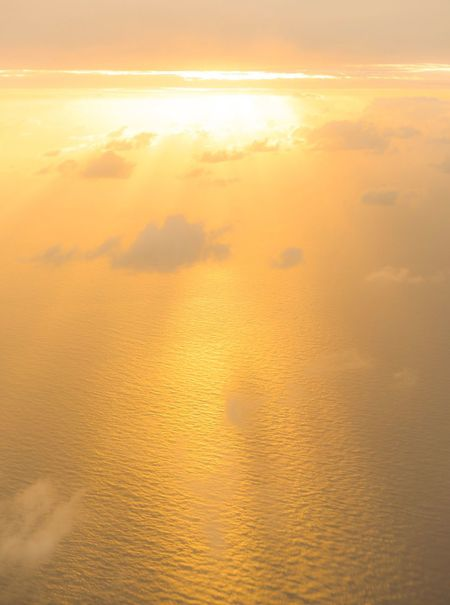 Sunset Sea Beauty In Nature Nature Orange Color Scenics Sky Water Tranquility Horizon Over Water No People Tranquil Scene Sun Outdoors Wave Day From An Airplane Window