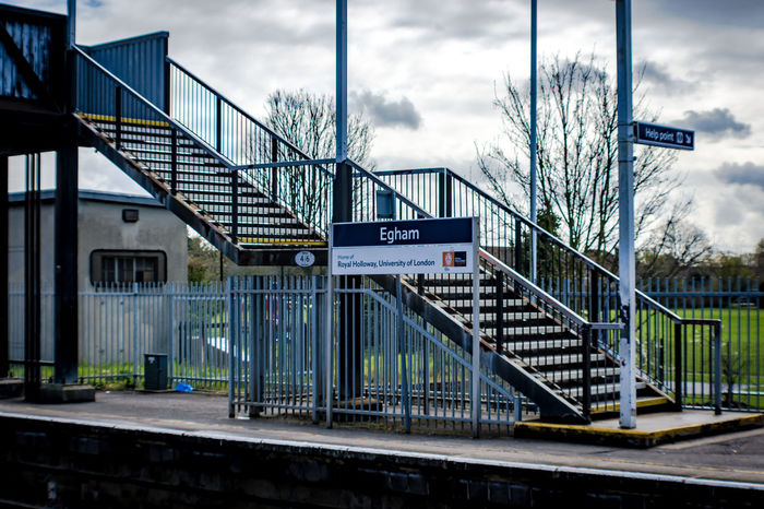 Loved England's Trains and Stations Architectural Column Architecture Building Built Structure City City Life Cloud Cloud - Sky Cloudy Day Egham Empty Having Fun Information Sign Modern No People Outdoors Pole Sign Sky Train Station Train Station Platform Travel Traveling Vacation