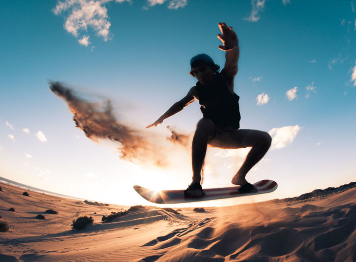 Extreme Beach Extreme Sports Leisure Activity One Person Outdoors Sandboard Sandboarding Sky Sunset Young Adult