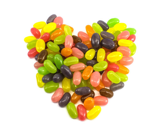Heart-shaped colorful jelly beans on white background Bean Capsule Close-up Heap Heart Jellyfish Multi Colored No People Ready-to-eat Shaped Studio Shot Valentine Variation White Background Yellow