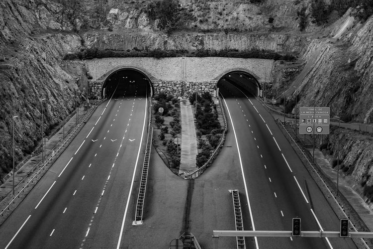 Mountain Tunnel Road Road Sign Transportation High Angle View Road Marking Architecture Symbol Sign Built Structure Track Nature Railroad Track Black & White Black And White Black And White Photography Trees Traffic Lights Outdoors Bnw_friday_eyeemchallenge