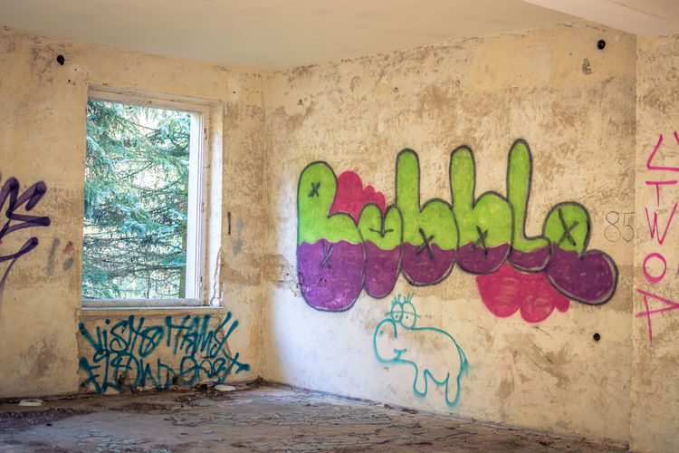 No People Architecture Built Structure Graffiti Art And Craft Indoors  Multi Colored Wall - Building Feature Creativity Window Day Wall Text Abandoned Paint Western Script Building Old Communication Mural