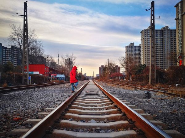 Railroad Track Rail Transportation Transportation Sky Outdoors Architecture Mirrored Reflection Railroad Track Light And Shadow Beijing, China Cityscape Street Photography City Life Huawei P9 Photos The Way Forward Urban Skyline Diminishing Perspective Day Cloud - Sky Shadows & Lights Tranquil Scene Freshness Transportation Modern City
