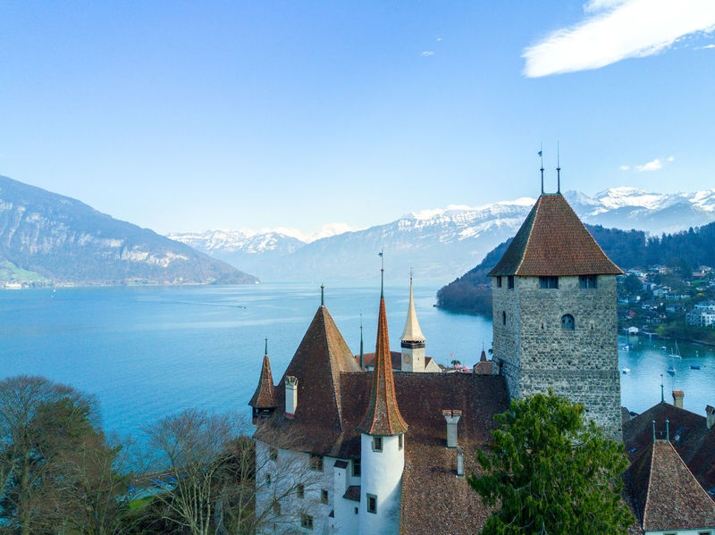 Architecture Building Exterior Built Structure Castle Day Mountain Mountain Range Nature No People Outdoors Place Of Worship Scenics Sky Spiez Switzerland Tree Water