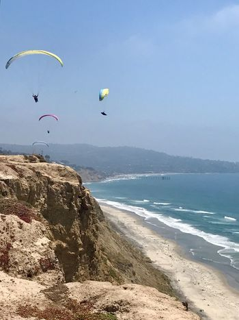 Flying High Flying Objects Parachute Paragliding Paragliding Over Water Cliffs Landscape Ocean Beach Cliffside Paragliding Iphone7 IPhone Photography Torrey Pines Blacks Beach Blue Paraglider Blue Sea Blue Ocean Blue Sky Flying Sky And Clouds
