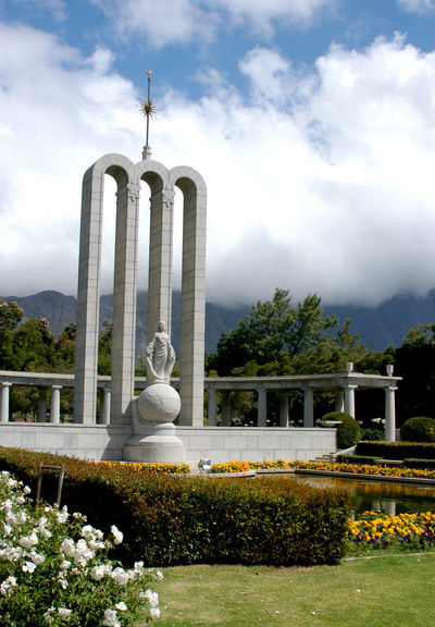 Long shot of Huguenot Memorial, Franschhoek, South Africa Art Buddha Built Structure Cape Town, South Africa Cloud Cloud - Sky Cloudy Day Franschhoek Grass Green Color Growth Huguenot Memorial Museum Huguenot Monument Nature No People Outdoors Plant Sculpture Sky South Africa Statue Travel Destinations Tree Western Cape