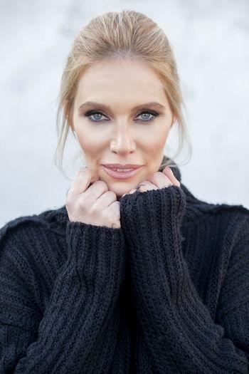 Close-Up Portrait Of Beautiful Woman Wearing Black Turtleneck