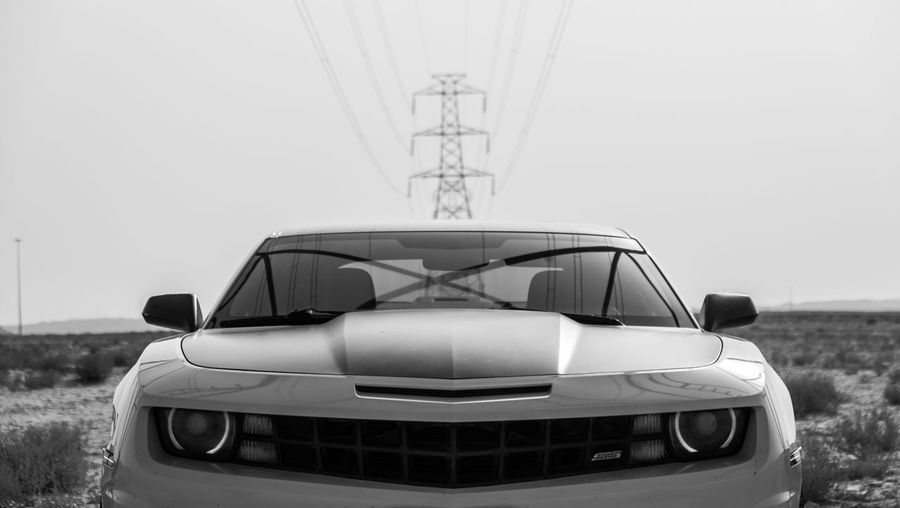 On desert with my bumblebee. Blackandwhite Black And White Cable Sky Outdoors High Power Lines Electricity Pylon Electric Symetry Industrial Reflection Architecture Desert Bumblebee Chevrolet Chevrolet Camaro Chevy Glass Sports Car